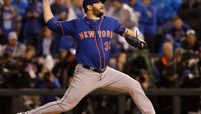 New York Mets pitcher Matt Harvey throws during the first inning of Game 1 of the Major League Baseball World Series against the Kansas City Royals Tuesday, Oct. 27, 2015, in Kansas City, Mo.