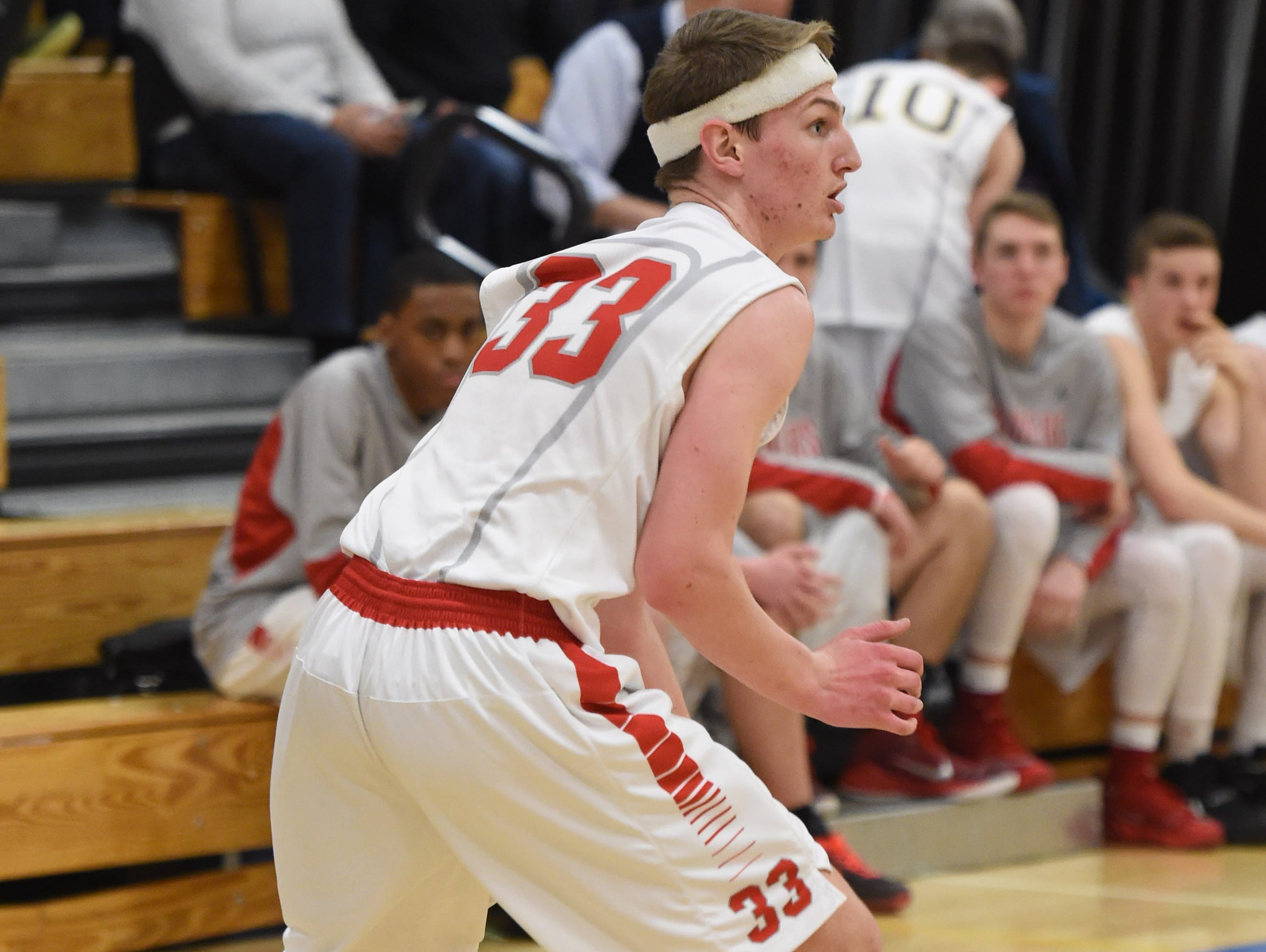 Red Hook High School's Colin Bemis looks to make a move against Poughkeepsie in the Mid-Hudson Athletic League semifinals on Feb. 17 at SUNY Ulster.