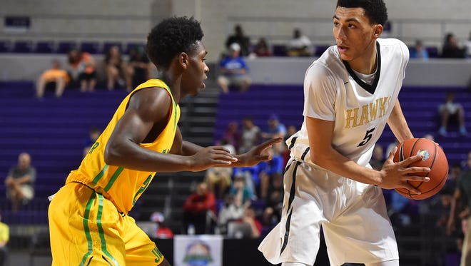 Jahvon Quinerly told Scout reporter Josh Gershon that he's still committed to Arizona 'for now.'