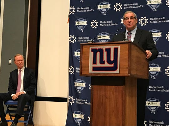Giants president and co-owner John Mara, left, watches new general manager Dave Gettleman during his introductory news conference Friday morning in East Rutherford, N.J.