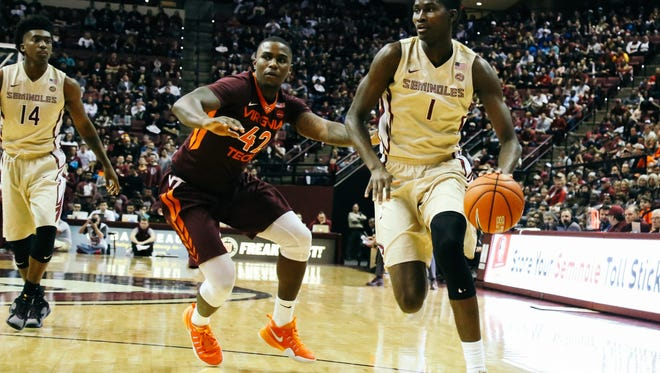 Jonathan Isaac (1) dribbles up the court during Florida State's 93-78 win over Virginia Tech in Tallahassee, Fla. on Saturday, January 7, 2017.