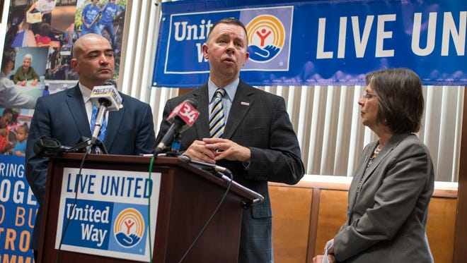 United Way of Broome County Executive Director Robin Alpaugh, center, speaks during a press conference in Vestal on Thursday details of ongoing work by the local Anti-Poverty Task Force and United Way of Broome County were discussed.