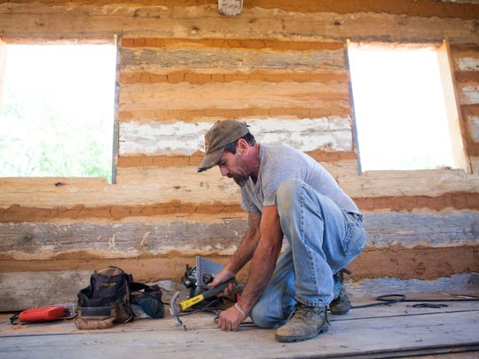 Stoney Caricofe, a carpenter with Frontier Culture Museum, works on securing floorboards inside Mount Tabor Church as part of the restoration project.