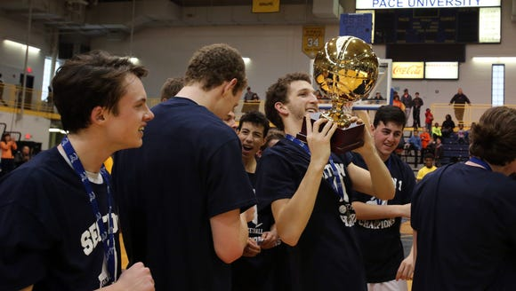 Briarcliff's Tucker Wexler holds the gold ball after
