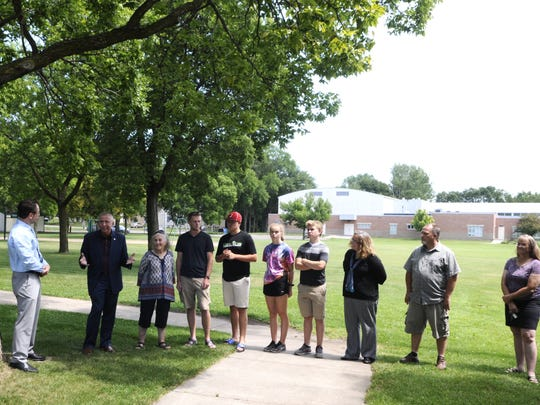 Mayor Dave Kleis, second from left, announces on Wednesday, July 26, that Southside Park will be named Haws Park. Also pictured are, from left, Parks Director Scott Zlotnik, Faye Haws, Connor Stark-Haws, Kevin Stark-Haws, Haiden Haws, Zander Haws, Shannon Haws, Tim Gibson and Kelly Haws.