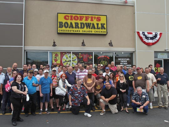 Participants of the 12th Annual Hot Dog Tour pose in front of Cioffi's Boardwalk in Union.