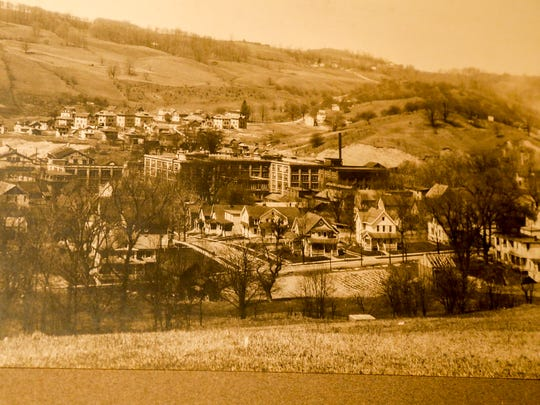A view from the hill overlooking the Corona Typewriter Factory in this undated photo. Beyond the factory on the opposite hill is a row of boarding houses, constructed by the company to house its workers.