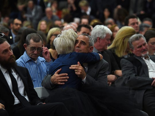 Daughter Erin Smith hugs her father, Greg Smith, during a public memorial service in honor of Sen. Debbie Smith at Sparks High School on Sunday.