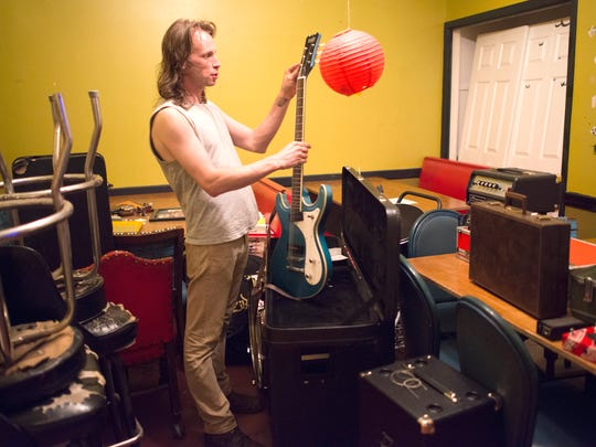 Pony Time guitarist, Luke Beethham, prepares to take the stage in the new Sluggo's entertainment room at the downtown Pensacola restaurant/nightspot.
