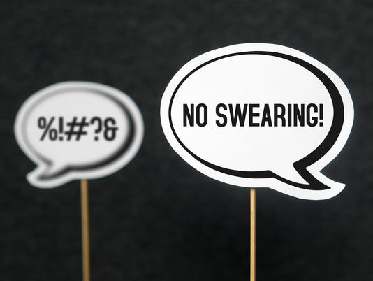 Swearing, cursing and bad language or behaviour in school, work or life. Concept of no dirty words and teaching good manners with speech balloons.