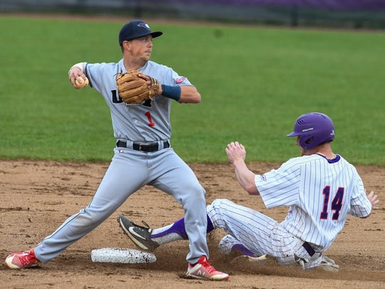 University of Southern Indiana'a Jacob Fleming (1) throws to first base after getting the tag on University of Evansville's Dalton Horstmeier (14) as the University of Southern Indiana Screaming Eagles play the University of Evansville Aces at Evansville's Braun Stadium Wednesday, April 25, 2018.
