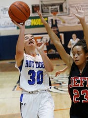 Frankfort's Natlie Kelly puts up a shot while guarded by Lafayette Jeff's Destynee Hampton in the J&C Hoops Classic Monday, November 16, 2015, at Harrison High School. Jeff beat Frankfort 60-23.