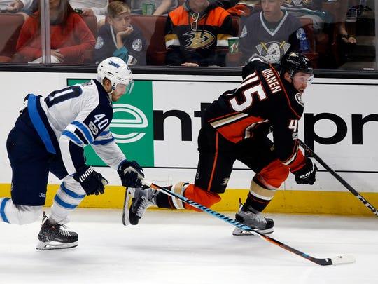 Anaheim Ducks defenseman Sami Vatanen (45), of Finland, breaks away from Winnipeg Jets right wing Joel Armia (40) during the third period of an NHL hockey game in Anaheim, Calif., Friday, Nov. 24, 2017. The Jets won 4-1. (AP Photo/Alex Gallardo)