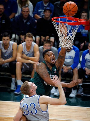 Michigan State's Nick Ward shoots against Hillsdale's Gordon Behr in the first half of an exhibition Friday, Nov. 3, 2017 in East Lansing.