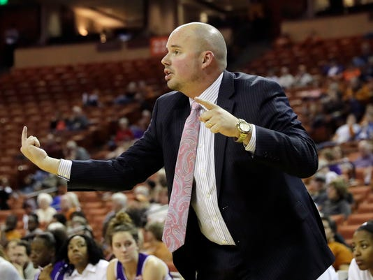 Northwestern State head coach Jordan Dupuy talks to his players during the first half of an NCAA college basketball game against Texas, Wednesday, Dec. 13, 2017, in Austin, Texas. (AP Photo/Eric Gay)