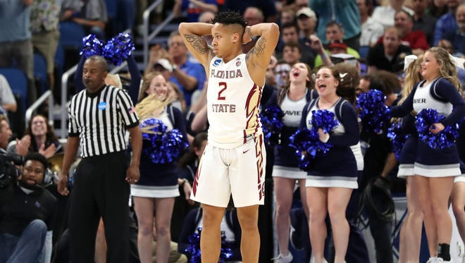 Florida State guard CJ Walker (2) reacts as they lose to the Xavier Musketeers in the second round of the 2017 NCAA Tournament at Amway Center.