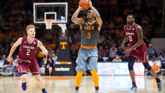 Tennessee's Robert Hubbs III attempts to score while South Carolina's Hassani Gravett, left, and Sindarius Thornwell try to defend in the second half of the game at Thompson-Boling Arena on Wednesday, January 11, 2017. Tennessee lost to South Carolina 70-60.