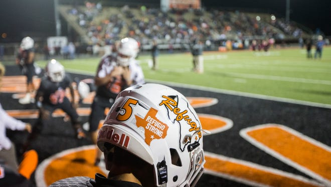 A Refugio player warms up before their game on Friday, Oct. 27, 2017, Bobcat Stadium.