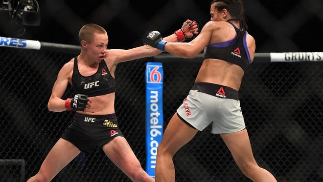 Rose Namajunas (Red Gloves) fights Joanna Jedrzezjczyk (Blue gloves) during UFC 223 at Barclays Center.