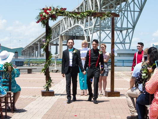 636321054089681612-60234001-2017-Pride-parade-AJ-Steven-wedding-15.jpg