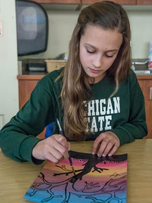 Marshall Middle School student Zoie Banfield works on her art during a recent class. Her school may take Albion's middle schoolers next semester.