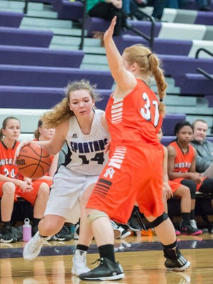 Lakeview's Kim Kucharczyk (14) drives toward the basket against Portage Northern on Tuesday evening.