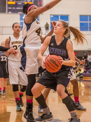Lakeview's Ava Cook (11) goes for the hoop while being guarded by Battle Creek Central's Jamesha Smith.