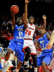 Middle Tennessee's Giddy Potts (20) goes for a layup against Western Kentucky's Fredrick Edmond (25) Saturday, January 30, 2016, during a game at E.A Diddle Arena. (Bac Totrong/photo@bgdailynews.com)