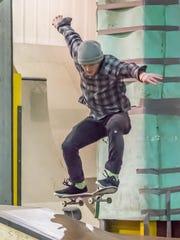 Anthony Trubiano of Kalamazoo flies over a ramp at Battleground: Indoor Bike/Skate.