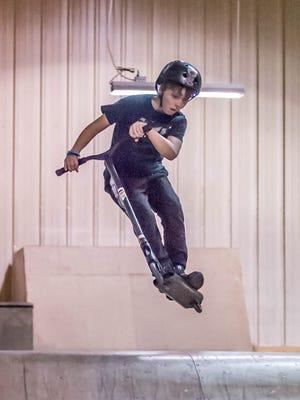 Trey Harvath,13, rides his scooter at Battleground: Indoor Bike/Skate.