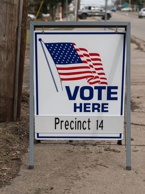 A sign for Battle Creek's Precinct 14 voters marks the polling location at 3142 Capital Ave. S.W. for Michigan's presidential primary election Tuesday.
