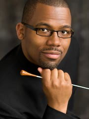Dr. Eugene Rogers, director of the University of Michigan Men's Glee Club.