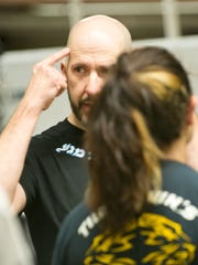 Tim Kubit, of Webster owns Krav Maga of Rochester, a school that trains military-style  fighting displines.