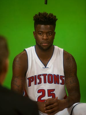 Detroit Pistons wing Reggie Bullock answers questions during media day in Auburn Hills on Sept. 25, 2016.