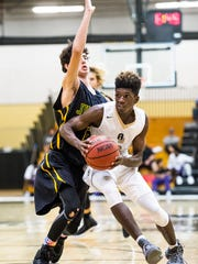 Golden Gate High School's James Harris brings the ball up court during the Gulfshore Holiday Hoopfest boys basketball tournament at Golden Gate High School in Golden Gate, Fla., on Tuesday, Dec. 27, 2016.