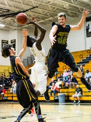 Golden Gate High School's James Harris gets his shot blocked by Jupiter's Richie McDonough(40) during the Gulfshore Holiday Hoopfest boys basketball tournament at Golden Gate High School in Golden Gate, Fla., on Tuesday, Dec. 27, 2016.