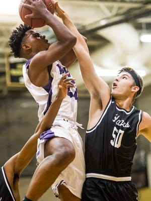 Timber Creek's Elwood Tomlinson tries to drive to the net during the semifinals at Gulfshore Holiday Hoopfest basketball tournament at Golden Gate High School in Golden Gate on Thursday, Dec. 29, 2016.