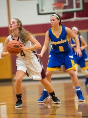Shippensburg's Maddie Bender (4) looks to make a pass as Waynesboro's Abby Ebersole (2) guards her during a girls basketball game on Tuesday, Jan. 3, 2016. Waynesboro defeated Shippensburg 59-42.