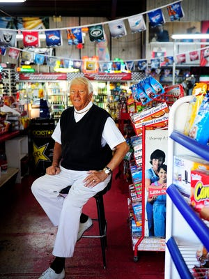 "In this 2014 file photo, Del Ackerman is seen in portrait in his store Friday, Jan. 3, at Del's 24 Hour Store in Naples, Fla. ""We've been opened since 1964 and never closed,"" Ackerman said proudly. Over the years he has been known to support those needing a second chance. ""What good is jail?"" Ackerman asked. ""Unless it's murder it doesn't make sense – I've been given second chances in life. If an employee steals from me, I make them pay back three times the cost and give them one more chance."" Ackerman also has been a huge support of the U.S. troops driving his patriotic 2003 Chevy SSR and through donations. ""They are important because you and I wouldn't be here today if they did not fight for us,"" Ackerman said. ""I feel they (veterans) have been mistreated."""