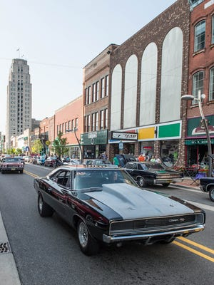 Cars cruise along Michigan Ave at the 2014 Cruise the Gut in downtown Battle Creek.Al Lassen/For the Enquirer