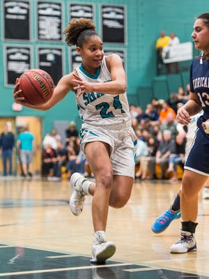 Gulf Coast High School's Yasmeen Chang tries to get past the defense during the Class 8A regional final over Palm Harbor University in Naples, Fla., on Friday, Feb. 17, 2017.