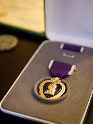 United States Army Corporal William B. Tiebout, Jr.'s Purple Heart award sits on display after an award ceremony held in his honor at the Washington's Headquarters historic site in Newburgh on Friday, July 26, 2013.