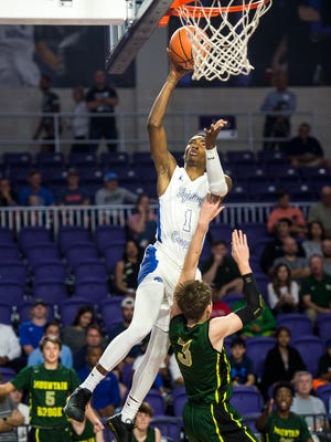 Canterbury School's Berrick Jeanlouis goes up for a shot during the City of Palms Classic on Monday, Dec. 18, 2017.