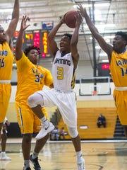 Lehigh High School's Bershard Edwards goes up for a