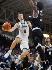 Florida Gulf Coast University's Christian Terrell pass under the net during a game against USC Upstate at Alico Arena in Fort Myers, Fla., on Thursday, Jan 11, 2018.