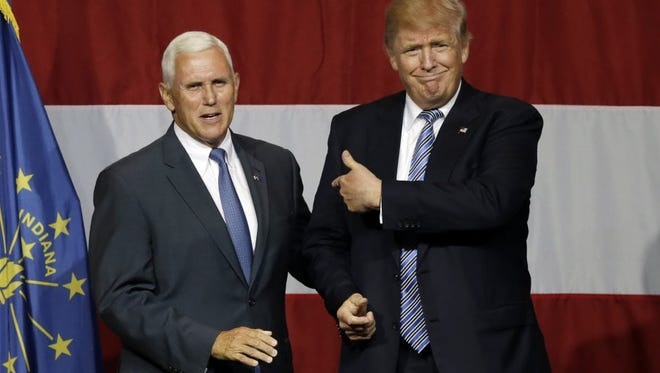 Indiana Gov. Mike Pence (left), the Republican vice presidential nominee, and GOP presidential nominee Donald Trump.