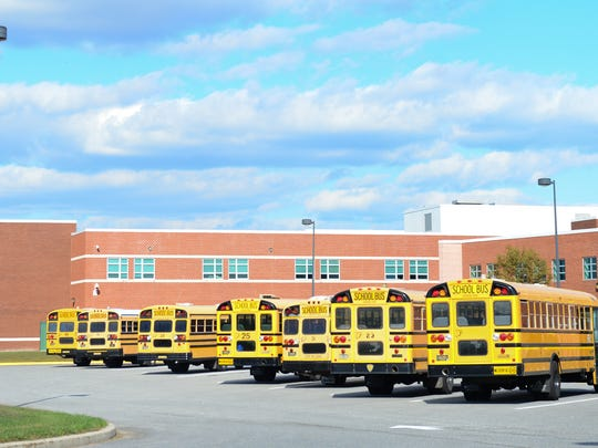 The Indian River School district bus' sits outside of Indian River High School on Tuesday, Oct. 26. 2016.