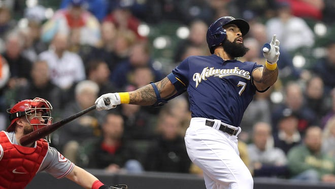 Eric Thames  launches a two-run homer off Reds starting pitcher Tyler Mahle in the third inning Wednesday.