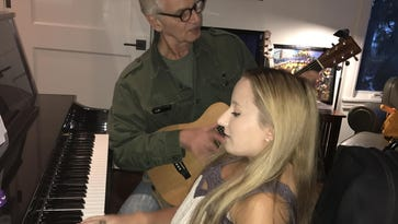 Singer-songwriter Ali McManus plays with record producer Jack Douglas. Douglas visited McManus at her home in Bloomfield Hills a few months ago.
