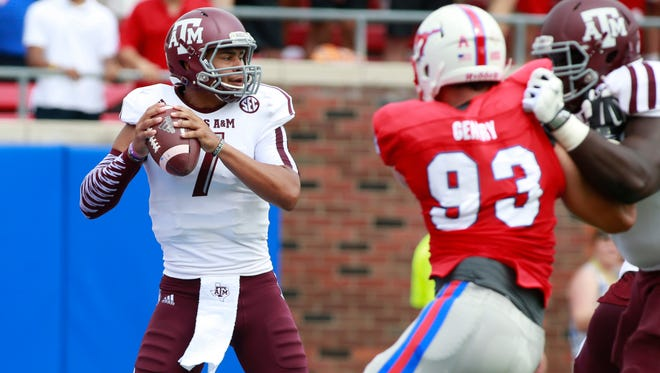 Texas A&M quarterback Kenny Hill (7) prepares to pass against Southern Methodist on Saturday. Hill threw for 265 yards and two touchdowns in the Aggies' 58-6 win.